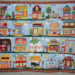 Darlene Morris machine embroidered rows of houses that highlighted events and items of importance in her life.  Darlene's quilt is whimsical and colorful!