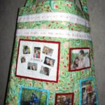 Sandy Dunning designed a tote bag with photos and pictures of important life events and family.  Sandy made the bag large enough to hold cutting mats and rulers!